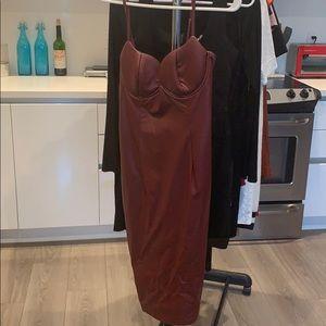 Burgundy leather dress.